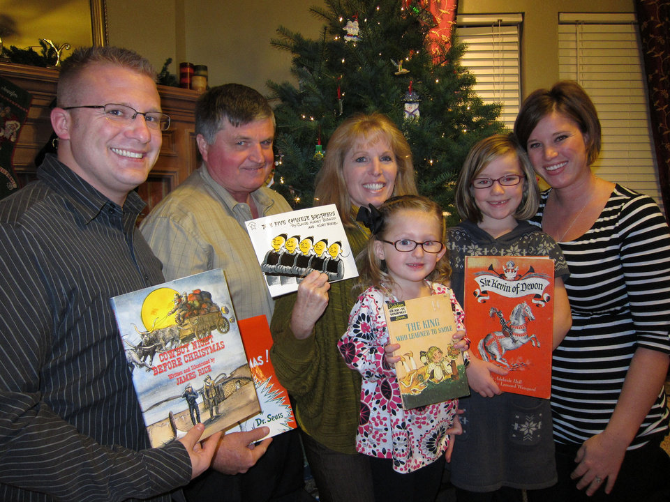 The Larsen family, of Edmond, traditionally shares their love of reading at Christmas Eve gatherings. From left are Tyler Larsen, Brad Larsen, Jan Larsen, Brynlee Larsen, 4, Makenna Larsen, 6, and Jennifer Larsen. Photo by Carla Hinton, The Oklahoman