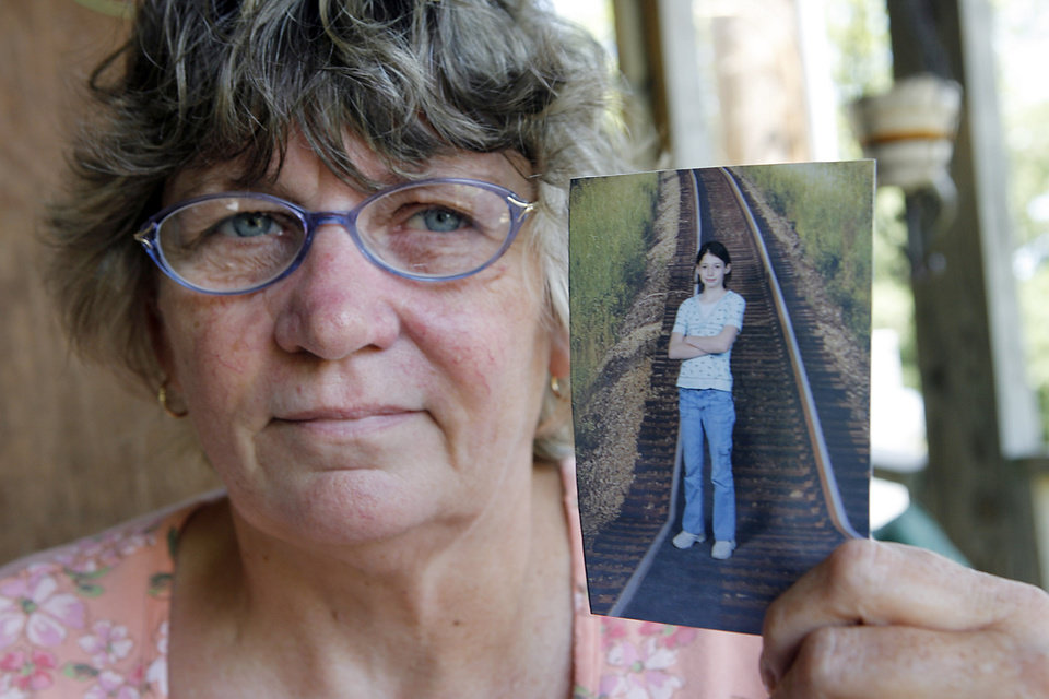 Photo - Claudia Farrow holds a photo of her granddaughter Skyla Whitaker who was shot and killed last Sunday near Weleetka, Wednesday, June 11, 2008.  Photo by David McDaniel /The Oklahoman