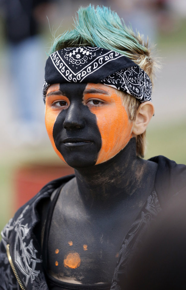 Photo - Lexington fan Rebecca Peltier sports face paint as the Purcell Dragons play the Lexington Bulldogs in high school football on Friday, Sept. 14, 2012, in Lexington, Okla.  Photo by Steve Sisney, The Oklahoman