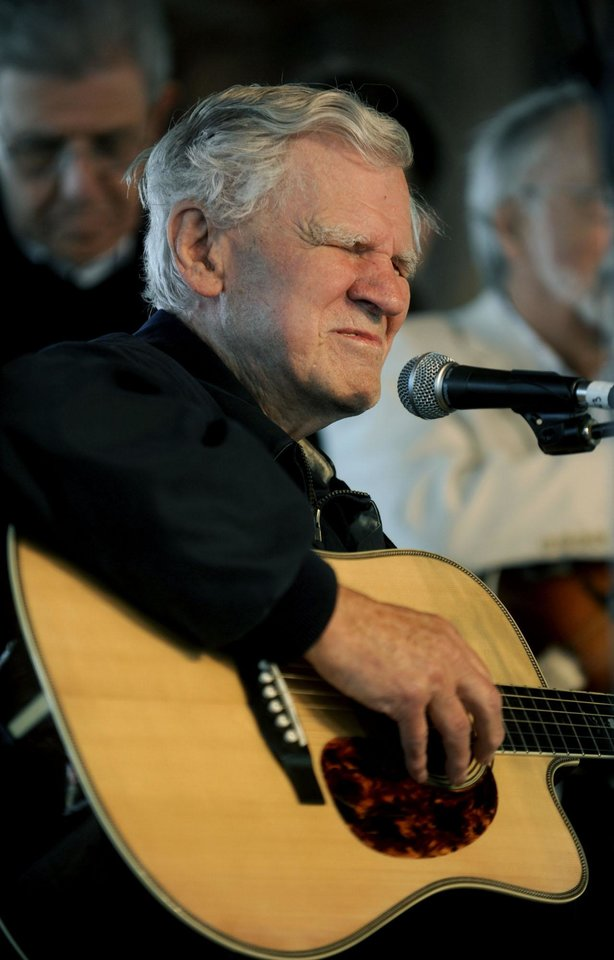 "FILE - In this May 1, 2011 file photo, master flatpicker Doc Watson performs with The Nashville Bluegrass Band during ""Spirit of Sunday"" during MerleFest in Wilkesboro, N.C. Watson, the Grammy-award winning folk musician whose lightning-fast style of flatpicking influenced guitarists around the world for more than a half-century, died Tuesday, May 29, 2012 at a hospital in Winston-Salem, according to a hospital spokeswoman and his management company. He was 89. (AP Photo/The Winston-Salem Journal, Lauren Carroll)"