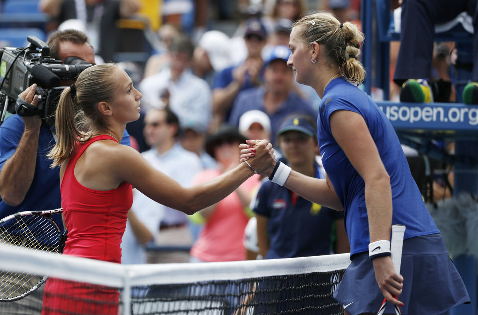 Photo - Aleksandra Krunic, of Serbia, left, greets Petra Kvitova, of the Czech Republic, after winning their third round match of the 2014 U.S. Open tennis tournament, Saturday, Aug. 30, 2014, in New York. (AP Photo/Kathy Willens)