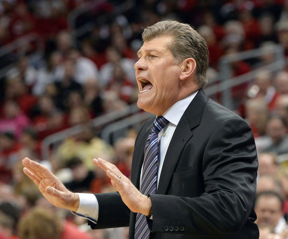 Photo - Connecticut head coach Geno Auriemma shouts instructions to his team during the first half of an NCAA college basketball game against Louisville, Monday, March 3, 2014, in Louisville, Ky. (AP Photo/Timothy D. Easley)