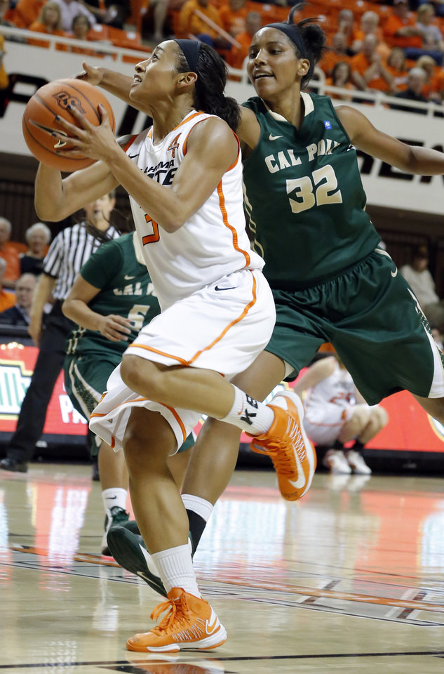 Oklahoma State's Tiffany Bias (3) shoots a lay up as Cal Poly's Brittany Woodard (32) defends during the women's college basketball game between Oklahoma State and Cal Poly at  Gallagher-Iba Arena in Stillwater, Okla., Friday, Nov. 9, 2012. Photo by Sarah Phipps, The Oklahoman