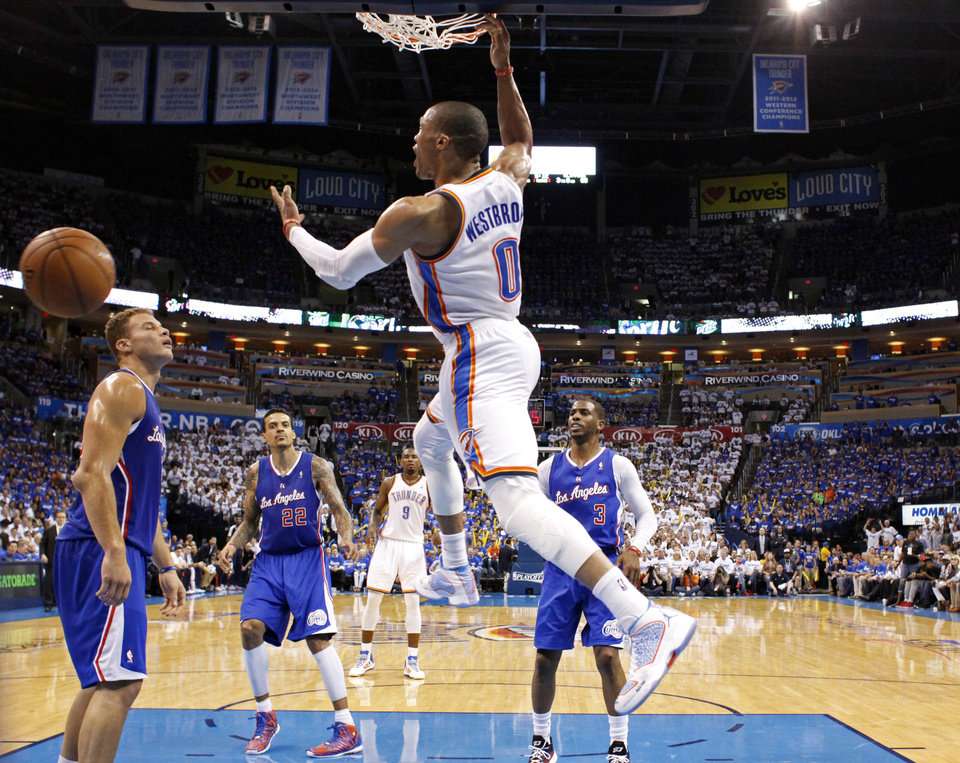 Photo - Oklahoma City's Russell Westbrook (0) celebrates a dunk in front of Blake Griffin (32) during Game 2 of the Western Conference semifinals in the NBA playoffs between the Oklahoma City Thunder and the Los Angeles Clippers at Chesapeake Energy Arena in Oklahoma City, Thursday, May 8, 2014. Photo by Sarah Phipps, The Oklahoman