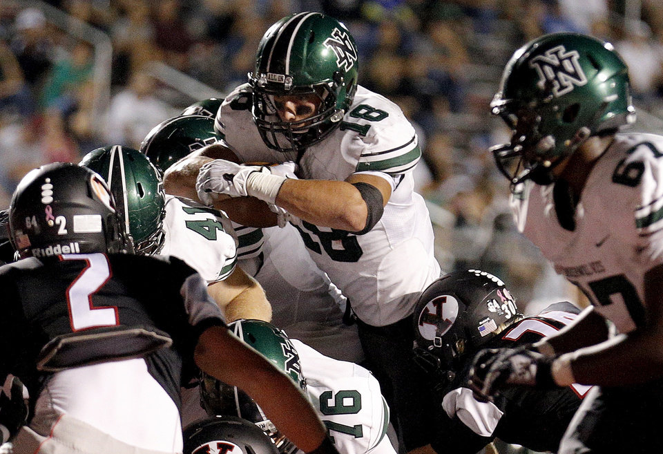 Norman North's Tyler Sipe dives into the end zone for a touchdown during a high school football game between Yukon and Norman North in Yukon, Okla.,   Friday, Oct. 4, 2013. Photo by Sarah Phipps, The Oklahoman