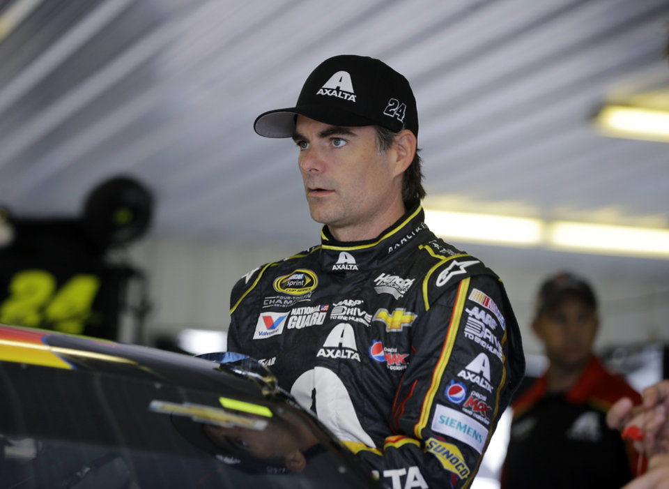 Photo - Jeff Gordon climbs into his race car for a practice session for Sunday's NASCAR Sprint Cup Series auto race at Pocono Raceway, Saturday, Aug. 2, 2014, Long Pond, Pa. (AP Photo/Mel Evans)