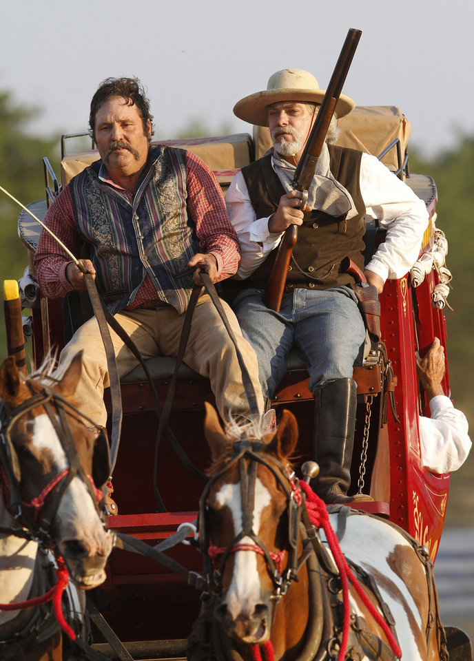 Photo - A driver and a cowboy riding shotgun take the stagecoach into the arena during the Pawnee Bill Wild West Show in Pawnee, Oklahoma on Saturday,  June 23, 2012.  Photo by Jim Beckel, The Oklahoman