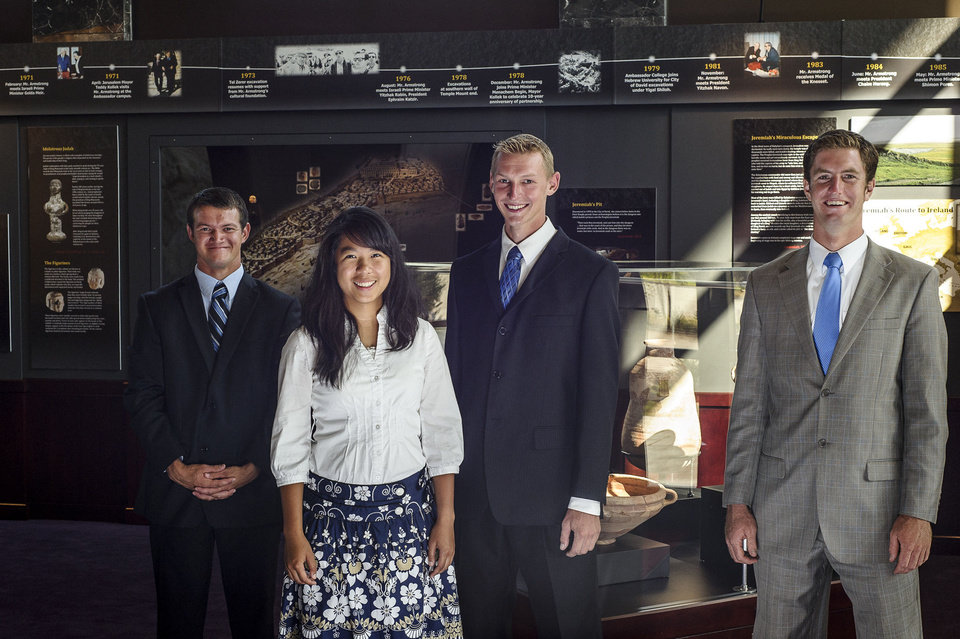 "Photo - Herbert W. Armstrong College students Bailey Crawford, Monica Antonio, Tyrel Schlote and Callum Wood pose at the ""Seals of Jeremiah's Captors Discovered"" exhibit in Armstrong Auditorium.Photo Provided"