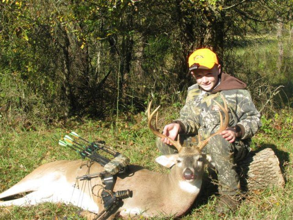 Photo -  Justin Mauldin of Tuttle and youth season buck