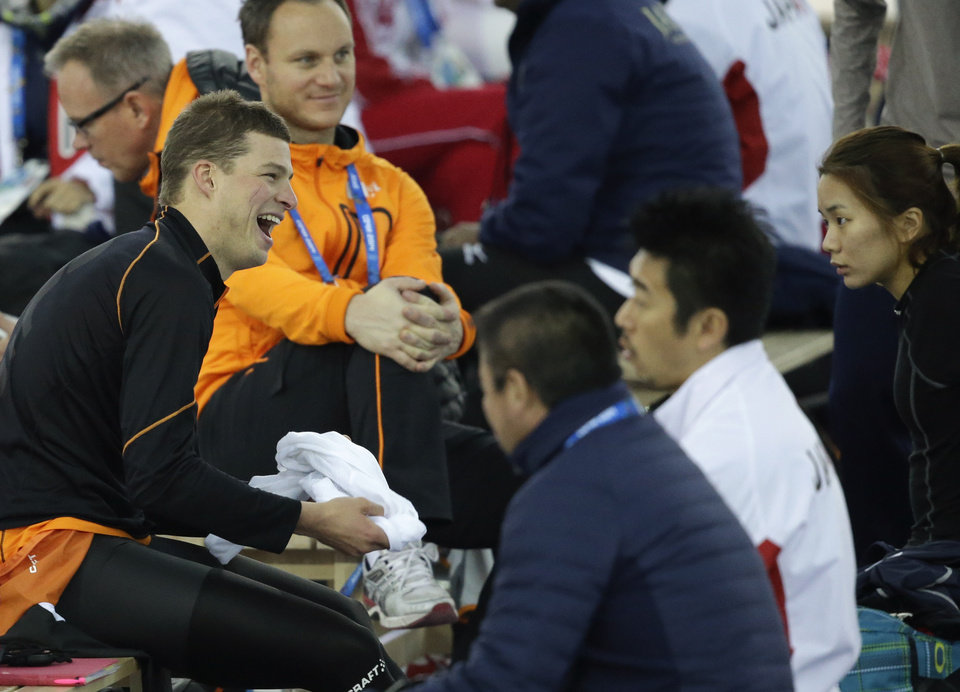 Photo - Sven Kramer of the Netherlands laughs as he  prepares for a training session at the Adler Arena Skating Center during the 2014 Winter Olympics in Sochi, Russia, Friday, Feb. 7, 2014. (AP Photo/Patrick Semansky)