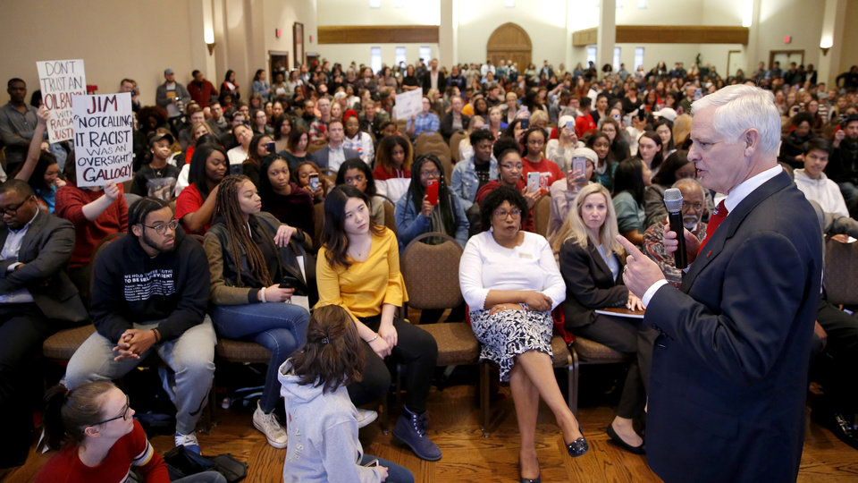 Photo - University of Oklahoma President James Gallogly talks to students and others during a Rally to Stop Racism, hosted by the Black Student Association, on the campus of the University of Oklahoma, Tuesday, Jan. 22, 2019. The rally was in response to a video that surfaced on social media of an OU student in blackface. Photo by Bryan Terry, The Oklahoman