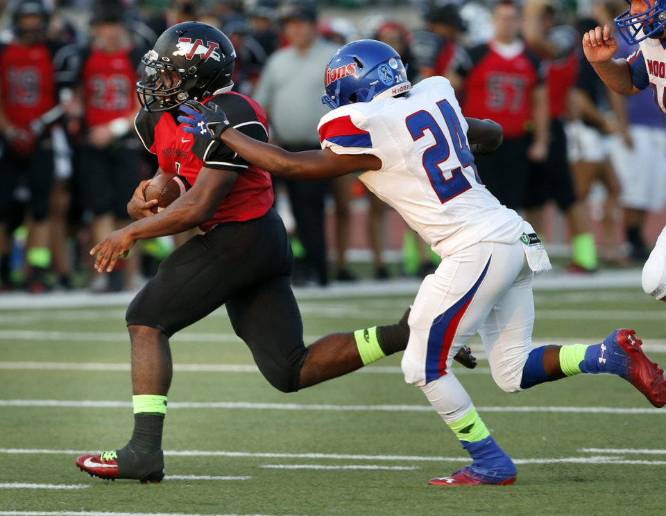 Photo - Jaguar Kieron Hardrtick eludes Devonte Cooper (24)and takes off on a touchdown run in the first half as Westmoore plays Moore High School on Friday, Sept. 6, 2013 in Moore, Okla.  Photo by Steve Sisney, The Oklahoman