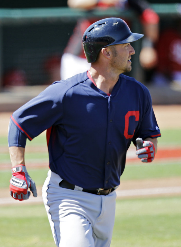 Photo - Cleveland Indians' Ryan Raburn runs out a two-run home run against the Cincinnati Reds in the third inning of a spring exhibition baseball game Monday, March 24, 2014, in Goodyear, Ariz. (AP Photo/Mark Duncan)