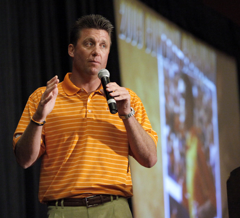 Oklahoma State football coach Mike Gundy speaks to a crowd during a Cowboy Caravan stop at the Cox Convention Center in Oklahoma City, Friday, July 31, 2009. Photo by Bryan Terry, The Oklahoman ORG XMIT: KOD