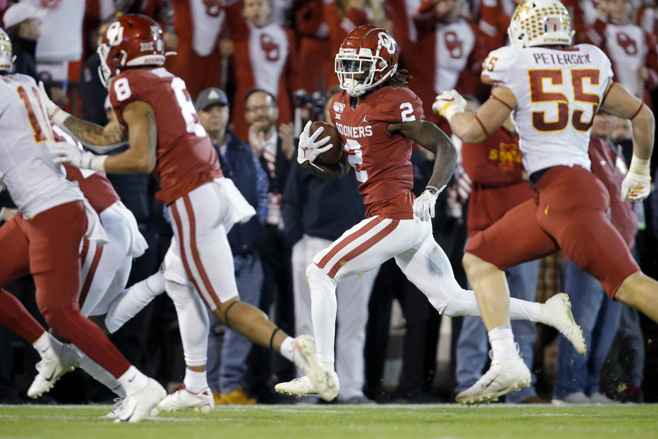 Photo - Oklahoma's CeeDee Lamb (2) runs to the end zone to score a touchdown during an NCAA football game between the University of Oklahoma Sooners (OU) and the Iowa State University Cyclones at Gaylord Family-Oklahoma Memorial Stadium in Norman, Okla., Saturday, Nov. 9, 2019. [Bryan Terry/The Oklahoman]