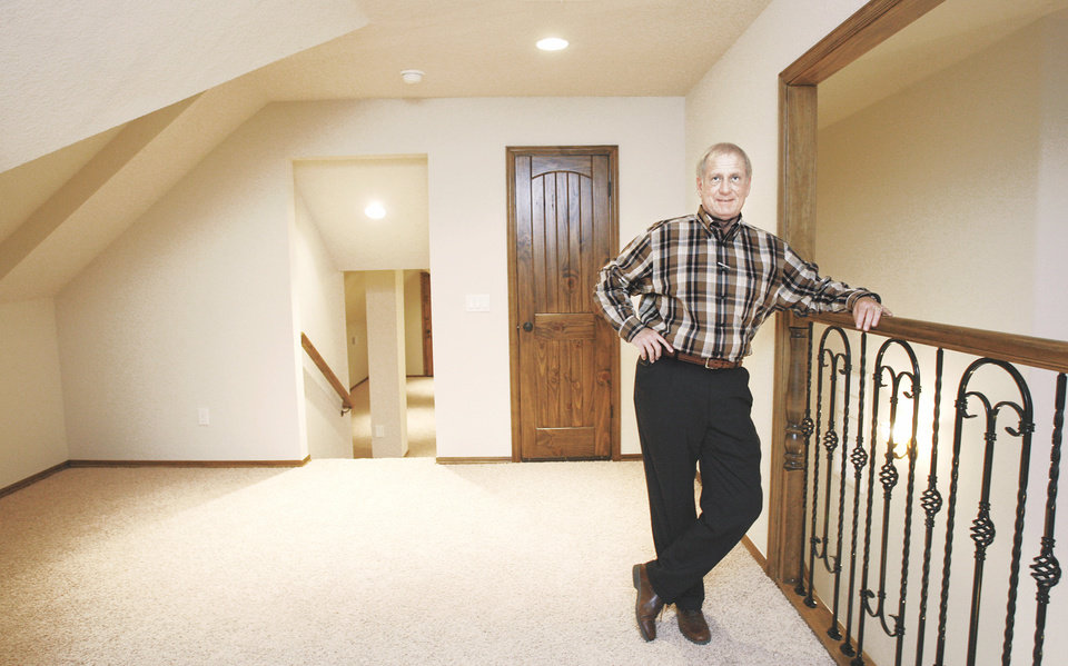 Photo - Jim McWhirter, shown in one of his model homes in the Castlegate addition in Choctaw, was named 2008 Builder of the Year at the Central Oklahoma Home Builders Association's annual banquet Friday night. photo by jim beckel, the oklahoman