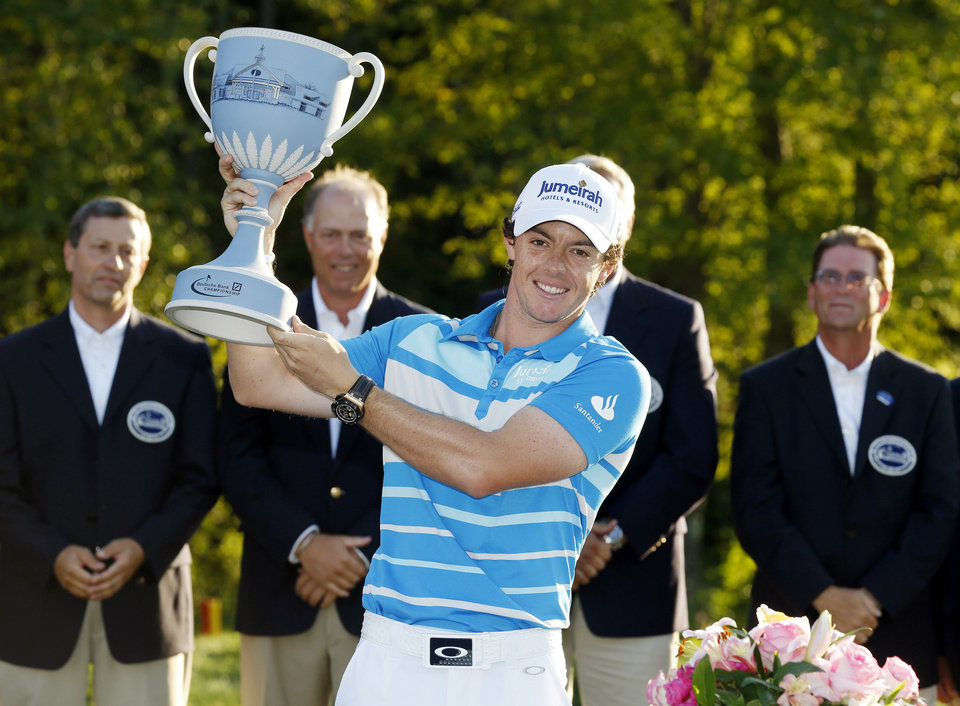 Photo -   Rory McIlroy, of Northern Ireland, holds the trophy after winning the Deutsche Bank Championship PGA golf tournament at TPC Boston in Norton, Mass., Monday, Sept. 3, 2012. (AP Photo/Michael Dwyer)