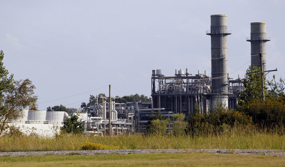 This Oct. 3, 2012 photograph shows cooling towers at the KGen Power Corporation natural gas-fired plant in Jackson, Miss. The plant may one day be owned by the New Orleans-based utility, Energy Corporation, as part of larger purchase, if allowed by the U.S. Justice Department, which has reservations about the purposed purchase. (AP Photo/Rogelio V. Solis)