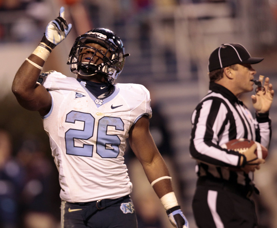 Photo -   North Carolina running back Giovani Bernard (26) celebrates a touchdown during the second half of an NCAA college football game at Scott stadium Thursday, Nov. 15, 2012 in Charlottesville, VA. North Carolina won the game 37-13. (AP Photo/Steve Helber)