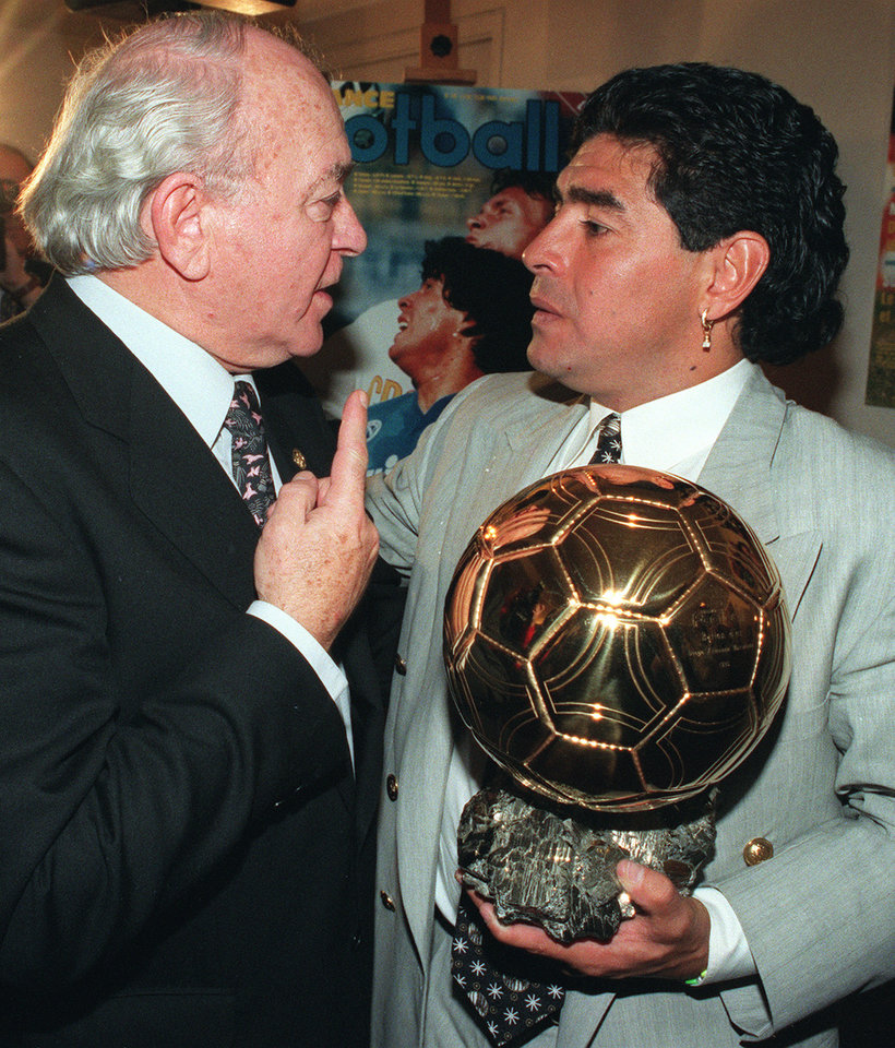 Photo - FILE - In this Jan. 3, 1995 file photo, former Argentina soccer star Alfredo di Stefano, left, congratulates fellow countryman Diego Maradona after he received the