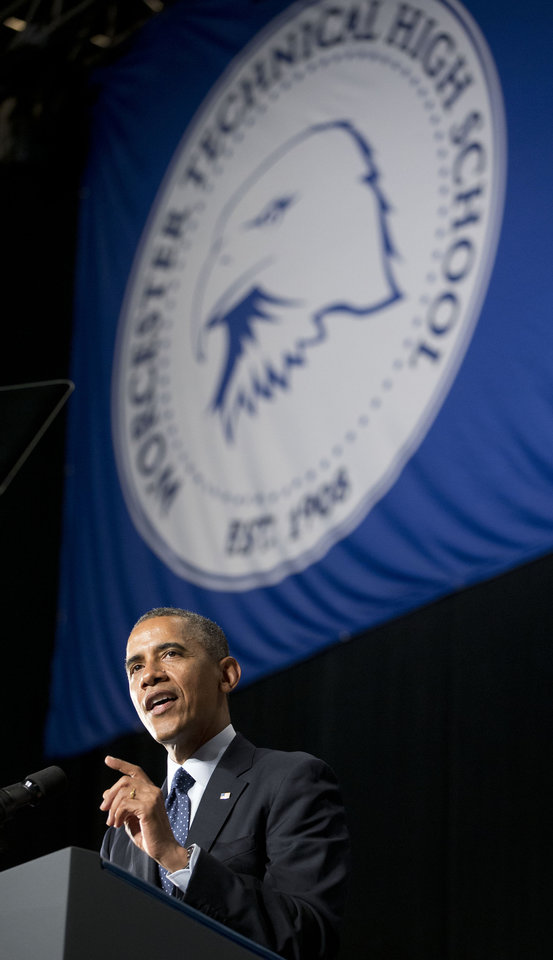 Photo - President Barack Obama delivers the commencement address for Worcester Technical High School, Wednesday, June 11, 2014, in Worcester, Mass. (AP Photo/Pablo Martinez Monsivais)