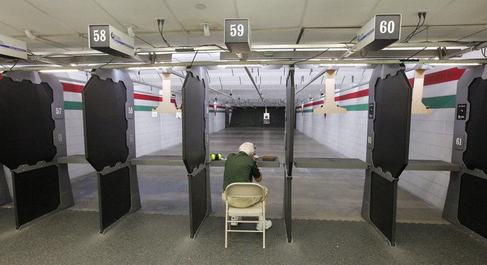 Photo -  Don Rice, of Midwest City, fires a rifle at the indoor shooting range Wednesday inside H & H Shooting Sports, 400 S Vermont, in Oklahoma City. Photos by Paul B. Southerland, The Oklahoman   PAUL B. SOUTHERLAND -