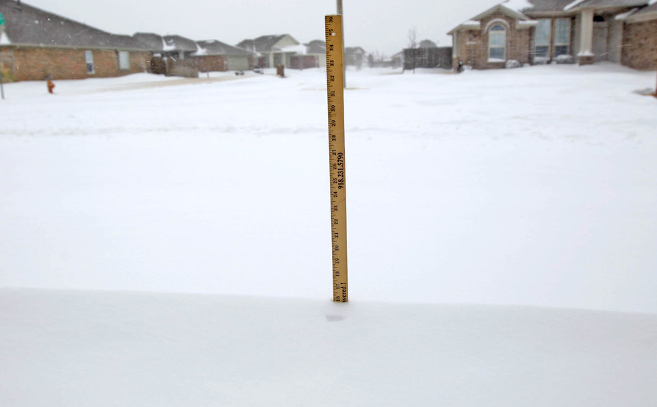 "A yard stick measures a drift of 16"" in northwest Oklahoma City during a major winter storm that hit central Oklahoma Tuesday, Feb. 1, 2011. Photo by Bryan Terry, The Oklahoman."