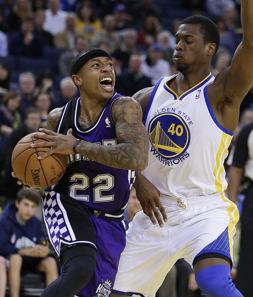 Sacramento Kings' Isaiah Thompson, left, drives the ball against Golden State Warriors' Harrison Barnes during the first half of an NBA basketball game Wednesday, March 6, 2013, in Oakland, Calif. (AP Photo/Ben Margot)
