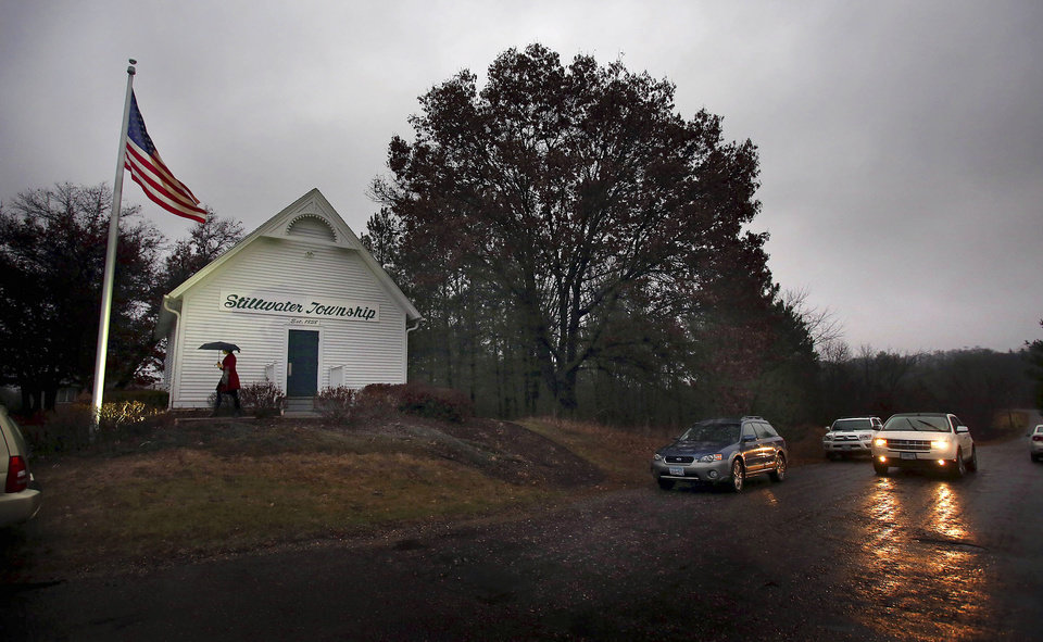 Photo -   Voters leave the Stillwater Township Hall after casting their ballots on Election Day, Tuesday, Nov. 6, 2012, in Stillwater Township, Minn. (AP Photo/The Star Tribune, Jim Gehrz) MANDATORY CREDIT; ST. PAUL PIONEER PRESS OUT; MAGS OUT; TWIN CITIES TV OUT