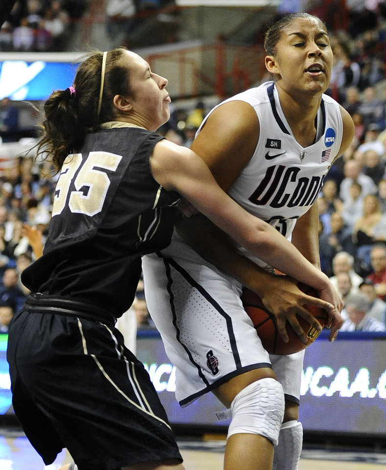 Photo - Connecticut's Kaleena Mosqueda-Lewis, right, is pressured by Idaho's Connie Ballestero, left, in the first half of a first-round game in the women's NCAA college basketball tournament in Storrs, Conn., Saturday, March 23, 2013. (AP Photo/Jessica Hill)