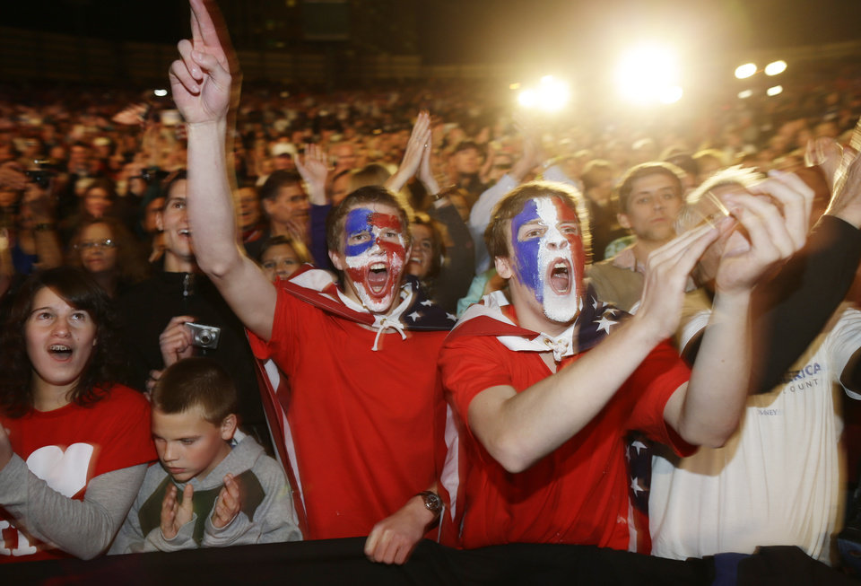 Supporters with their faces painted in the colors of the U.S. flag cheer for Republican presidential candidate and former Massachusetts Gov. Mitt Romney campaigns at Comfort Dental Amphitheater in Englewood, Colo. on Saturday, Nov. 3, 2012. (AP Photo/Charles Dharapak)