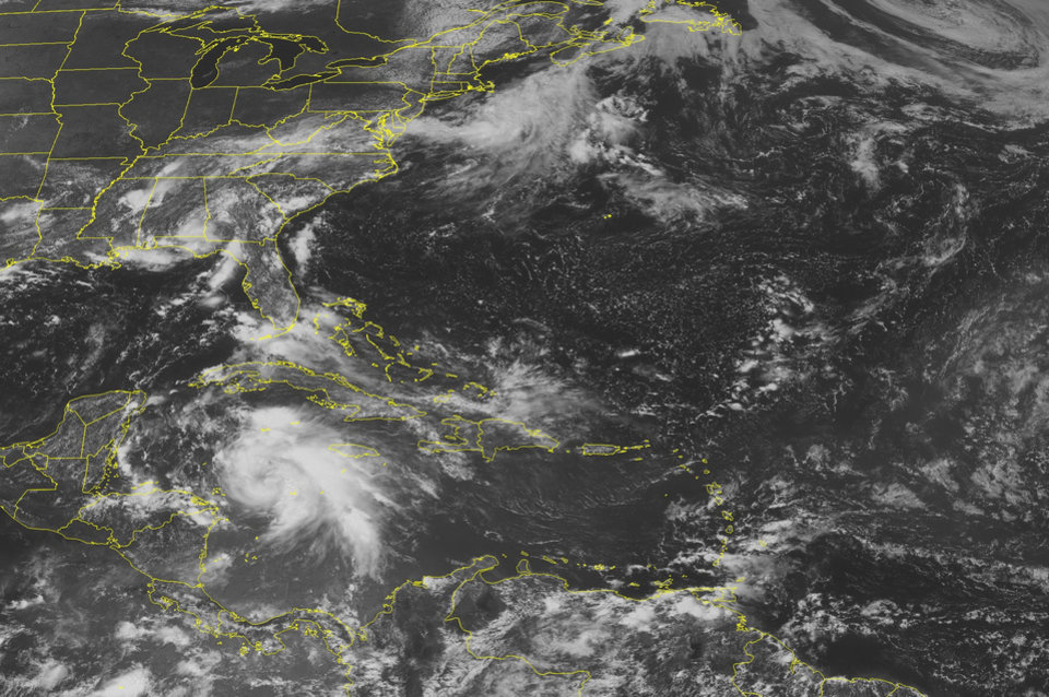 Photo -   This NOAA satellite image taken Monday, Aug. 6, 2012 at 1:45 p.m. EDT shows a swirl of clouds in the western Caribbean Sea associated with Tropical Storm Ernesto as it moves toward the Yucatan Peninsula. This storm is expected to strengthen into a hurricane later Monday before possibly making landfall in northern Belize Wednesday. Ernesto could strengthen once it emerges in the Bay of Campeche. (AP Photo/Weather Underground)