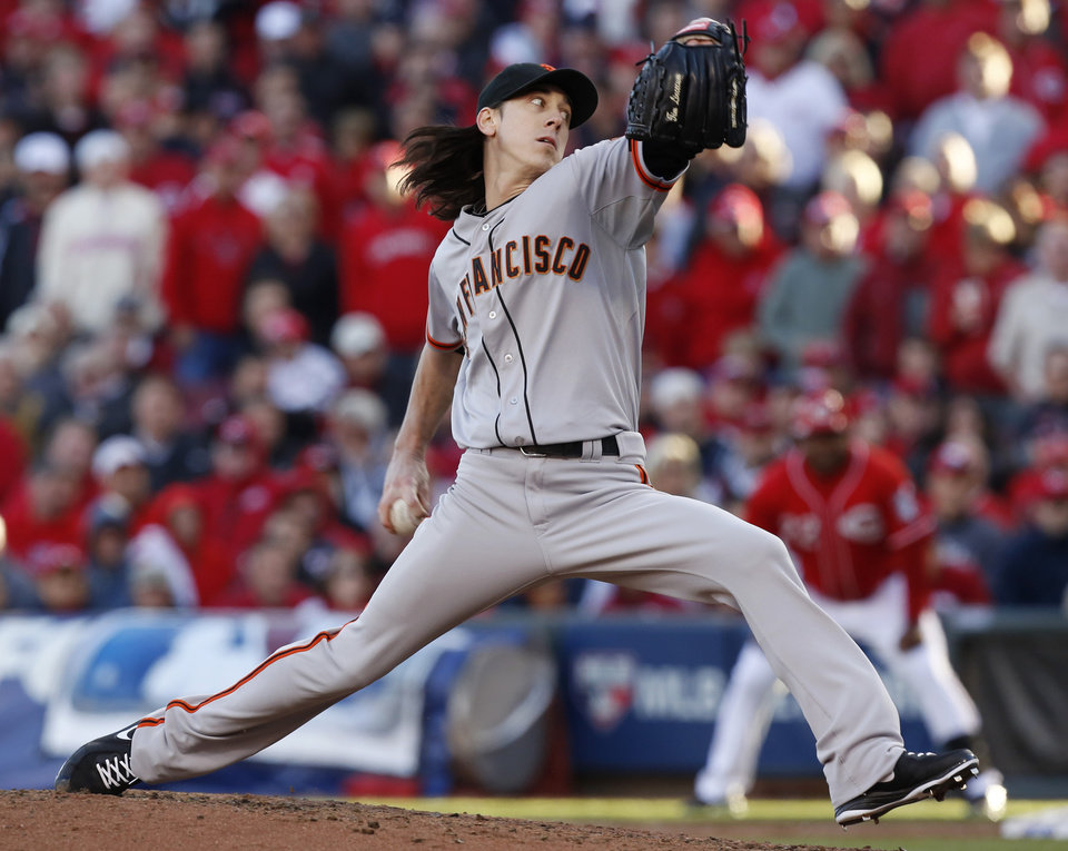 San Francisco Giants relief pitcher Tim Lincecum throws against the Cincinnati Reds in the fifth inning of Game 4 of the National League division baseball series, Wednesday, Oct. 10, 2012, in Cincinnati. (AP Photo/David Kohl)