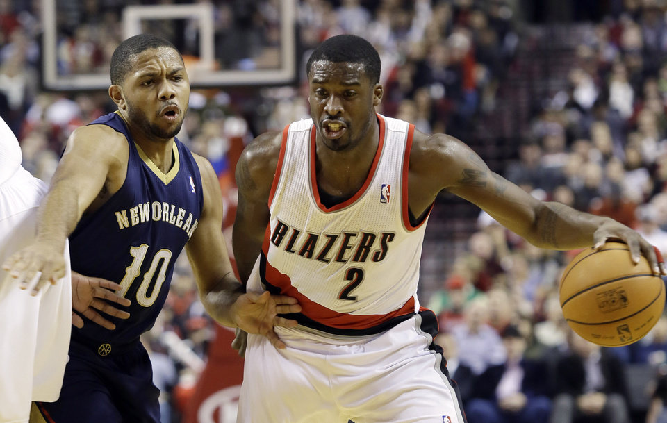 Photo - Portland Trail Blazers guard Wesley Matthews, right, drives past New Orleans Pelicans guard Eric Gordon during the first half of an NBA basketball game in Portland, Ore., Saturday, Dec. 21, 2013. (AP Photo/Don Ryan)