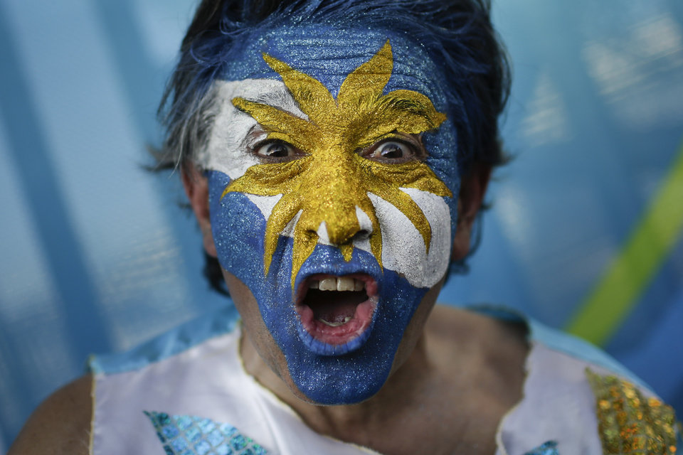 Photo - An Argentina soccer fan cheers as he poses for a photo outside the Maracana Stadium before the group F World Cup soccer match between Argentina and Bosnia in Rio de Janeiro, Brazil, Sunday, June 15, 2014.  (AP Photo/Felipe Dana)