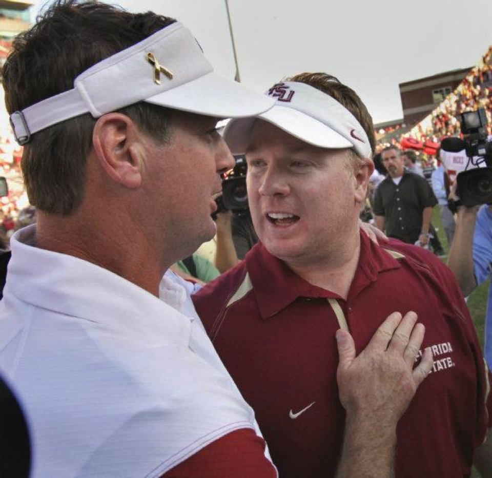 Photo - OU head coach Bob Stoops (left) and his brother Mark greet after the college football game where the University of Oklahoma Sooners defeated the Florida State University Seminoles (FSU) 47-17 at the Gaylord Family-Oklahoma Memorial Stadium on Saturday, Sept. 11 2010, in Norman, Okla. Photo by Steve Sisney, The Oklahoman  STEVE SISNEY