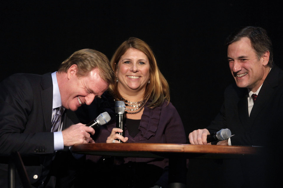 NFL Commissioner Rodger Goodell, left, laughs with hosts Jennifer Hammond and Dan Miller during a Detroit Lions charity event, Tuesday, Nov. 27, 2012, in Detroit. (AP Photo/Detroit Free Press, Jarrad Henderson) NO SALES MAGS OUT TV OUT DETROIT NEWS OUT MANDATORY CREDIT