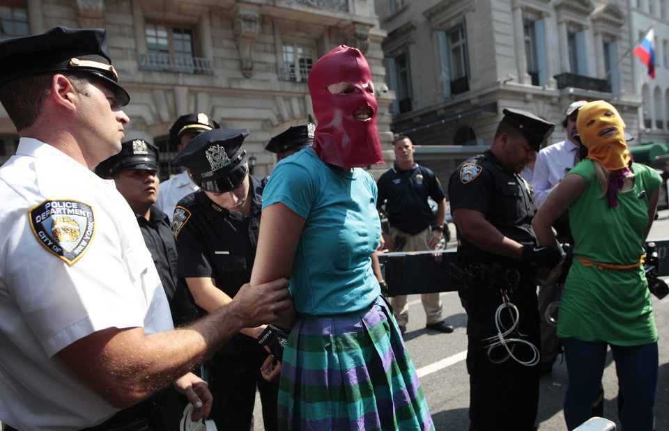 Photo -   Protesters are arrested during a demonstration in front of the Russian consulate in support of Russian punk band Pussy Riot, Friday, Aug. 17, 2012 in New York. A Russian judge found three members of the provocative punk band guilty of hooliganism on Friday, in one of the most closely watched cases in recent Russian history. The judge said the three band members committed hooliganism driven by religious hatred and offending religious believers. The three were arrested in March after a guerrilla performance in Moscow's main cathedral calling for the Virgin Mary to protect Russia against Vladimir Putin, who was elected to a new term as Russia's president a few days later. (AP Photo/Mary Altaffer)