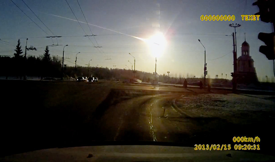 Photo - In this frame grab made from a video done with a dashboard camera a meteor streaks through the sky over Chelyabinsk, about 1500 kilometers (930 miles) east of Moscow,  Friday, Feb. 15, 2013. A meteor that scientists estimate weighed 10 tons (11 tons) streaked at supersonic speed over Russia's Ural Mountains on Friday, setting off blasts that injured some 500 people and frightened countless more. (AP Photo/AP Video)