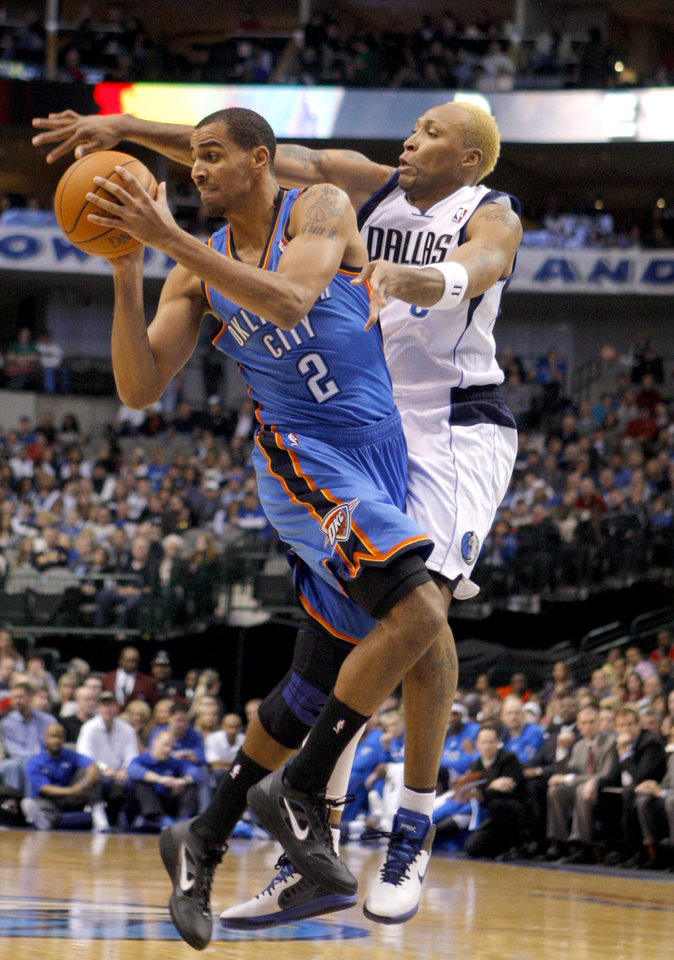 Photo - Oklahoma City's Thabo Sefolosha (2) looks to pass the ball as Dallas' Vince Carter (0) defends him during the pre season NBA game between the Dallas Mavericks and the Oklahoma City Thunder at the American Airlines Center in Dallas, Sunday, Dec. 18, 2011. Photo by Sarah Phipps, The Oklahoman