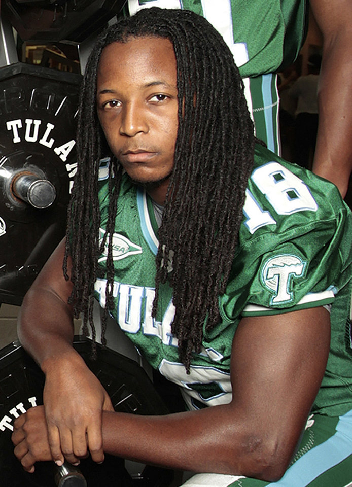 Photo -   This Aug. 10, 2011, photo shows Tulane safety Devon Walker posing for a photograph in the Tulane University weight room in New Orleans. Walker fractured his spine in a head-to-head collision with a teammate during an NCAA college football game against Tulsa, Saturday, Sept. 8, 2012, in Tulsa, Okla., according to the team doctor. (AP Photo/The Times-Picayune, Chris Granger) MAGS OUT; NO SALES; USA TODAY OUT