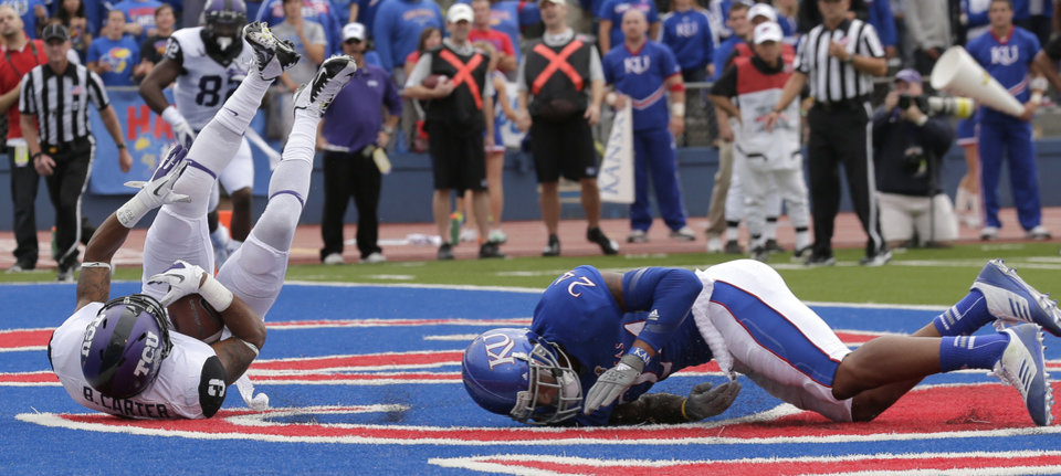 Photo -   TCU wide receiver Brandon Carter (3) falls into the end zone out of the reach of Kansas safety Bradley McDougald (24) to score a touchdown during the first half of an NCAA college football game, Saturday, Sept. 15, 2012, in Lawrence, Kan. (AP Photo/Charlie Riedel)