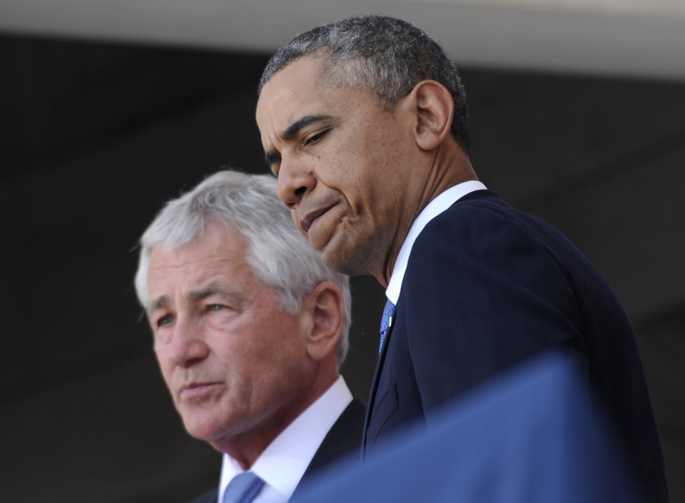 Photo - President Barack Obama and Defense Secretary Chuck Hagel participate in a Memorial Day ceremony at Arlington National Cemetery in Arlington, Va., Monday, May 26, 2014. Obama, who returned just hours earlier from a surprise visit with U.S. troops at Bagram Air Field in Afghanistan, paid tribute to those lost in battle there and elsewhere over history as he commemorated Memorial Day.  (AP Photo/Susan Walsh)