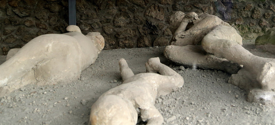 Photo - In this May 14, 2014 photo, plaster casts showing victims as they were overcome by the heat and toxic gases of the volcanic eruption of Mount Vesuvius, which in A.D. 79 destroyed the ancient town of Pompeii, near modern-day Naples, Italy. The victims were found in an orchard that came to be known as the Garden of the Fugitives, a reference to the doomed locals' attempts to flee disaster. An estimated 2.5 million people visit the ruins each year. (AP Photo/Michelle Locke)