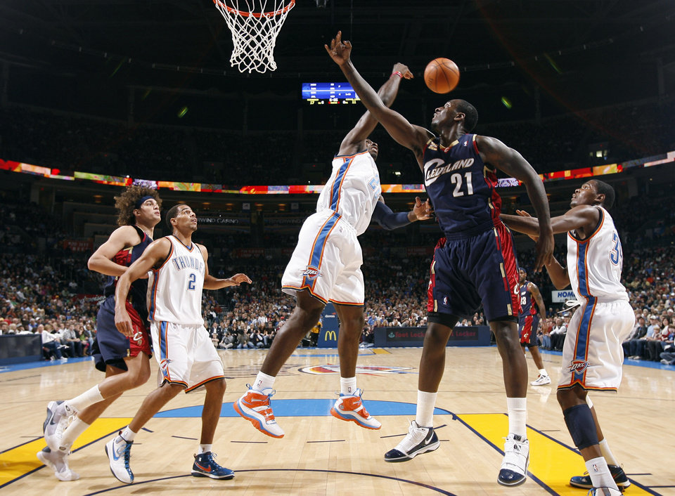 Photo - Oklahoma City's Jeff Green (22) blocks Cleveland's J.J. Hickson (21) shot during the NBA game between the Oklahoma City Thunder and the Cleveland Cavaliers, Sunday, Dec. 13, 2009, at the Ford Center in Oklahoma City. Photo by Sarah Phipps, The Oklahoman