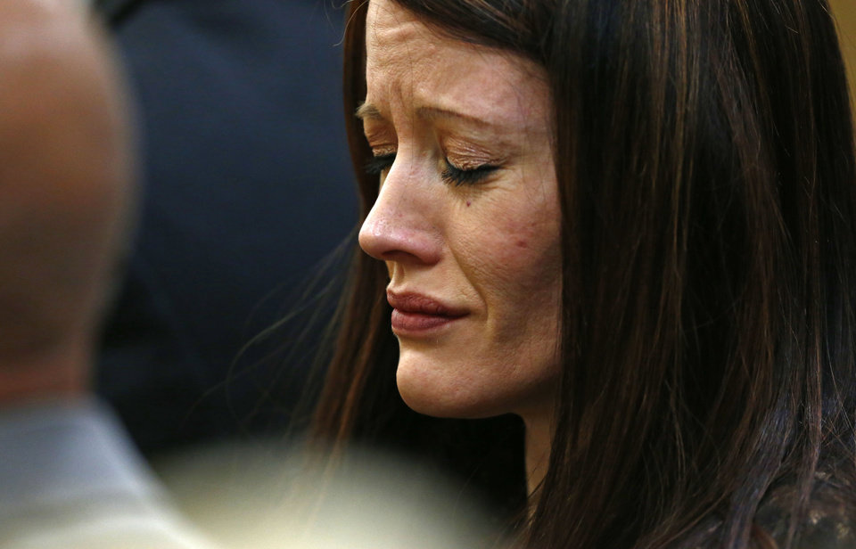 Photo - Tanisha Sorenso closes her eyes as autopsy photos of her brother Travis Alexander are displayed on Wednesday, May 15, 2013 during the sentencing phase of the Jodi Arias murder trial at Maricopa County Superior Court in Phoenix. If the jury finds aggravating factors in her crime, Arias could be sentenced to death. Jodi Arias was convicted of first-degree murder in the stabbing and shooting to death of Travis Alexander, 30, in his suburban Phoenix home in June 2008. (AP Photo/The Arizona Republic, Rob Schumacher, Pool)