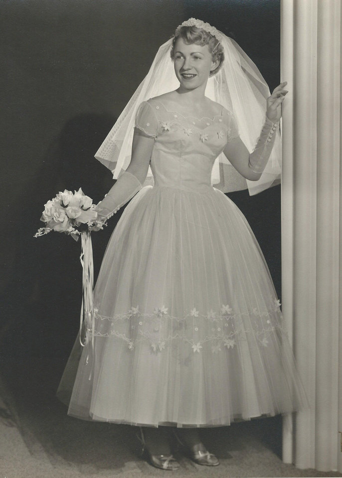 Photo - In an ice blue dress, Velma Lee Smith Koelsch's shorter hemline gown helped her fit in to the trends of the 1950s. She was married in May 1957. Photo provided by Robbin Koelsch.