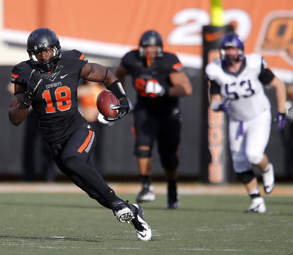 Photo - Oklahoma State's Blake Jackson (18) runs after making a catch as TCU's David Johnson (53) chases him down during a college football game between Oklahoma State University (OSU) and Texas Christian University (TCU) at Boone Pickens Stadium in Stillwater, Okla., Saturday, Oct. 27, 2012. Photo by Sarah Phipps, The Oklahoman