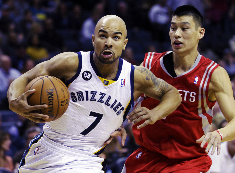 Memphis Grizzlies' Jerryd Bayless (7) drives past Houston Rockets' Jeremy Lin, right, during the first half of an NBA basketball game in Memphis, Tenn., Friday, Nov. 9, 2012. (AP Photo/Daniel Johnston)