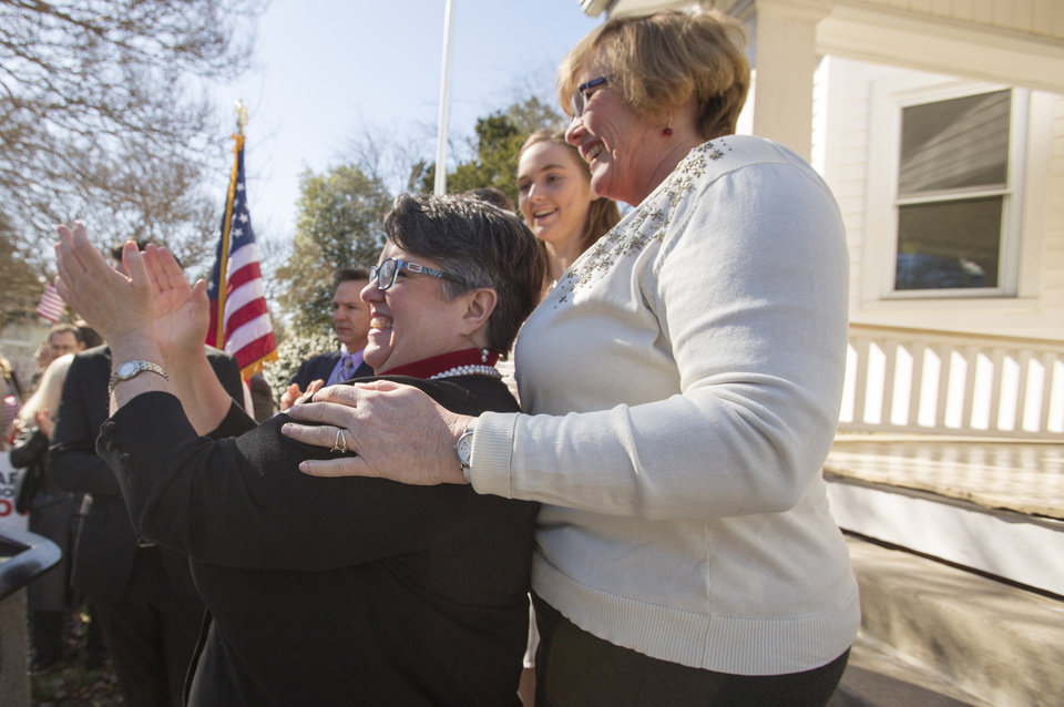 Photo - From left: Carol Schall  and Mary Townley celebrate Thursday's ruling by federal Judge Arenda Wright Allen that Virginia's same-sex marriage ban was unconstitutional during a news conference, Friday, Feb. 14, 2014 in Norfolk, Va.  Wright Allen on Thursday issued a stay of her order while it is appealed, meaning that gay couples in Virginia still won't be able to marry until the case is ultimately resolved. An appeal will be filed to the 4th District Court of Appeals, which could uphold the ban or side with Wright Allen.  (AP Photo/The Virginian-Pilot, Bill Tiernan)  MAGS OUT